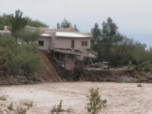 house falling into Cave Creek